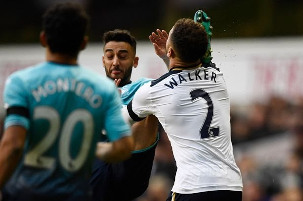 Swansea-Citys-Neil-Taylor-catches-Tottenhams-Kyle-Walker-in-the-face-with-his-foot.jpg